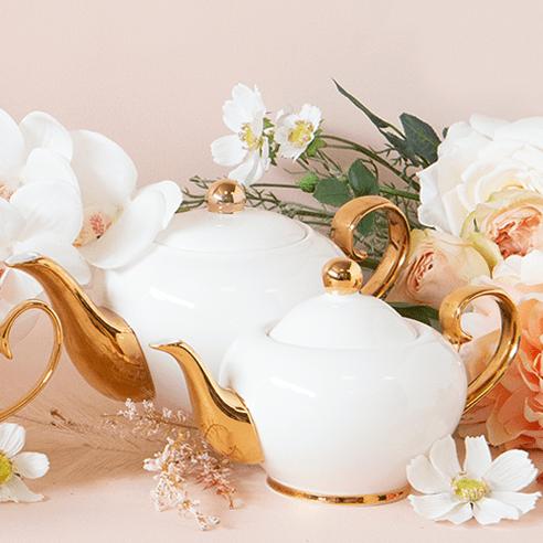 2 white teapots